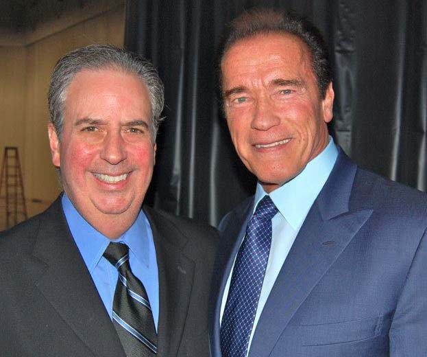Dr. Nick and old friend Arnold Schwarzenegger backstage at American Academy of Anti-Aging Medicine in Las Vegas